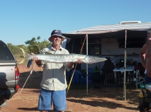 Proud fisherman with huge Barracuda