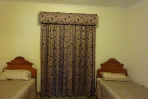 2nd hand curtains, changing fashions account for good bargains.