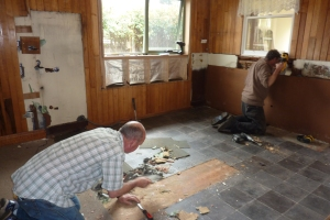 Tom and Paul working in the gutted kitchen.