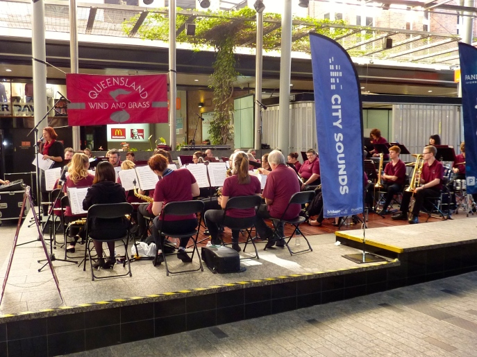 Orchestra playing in city centre.